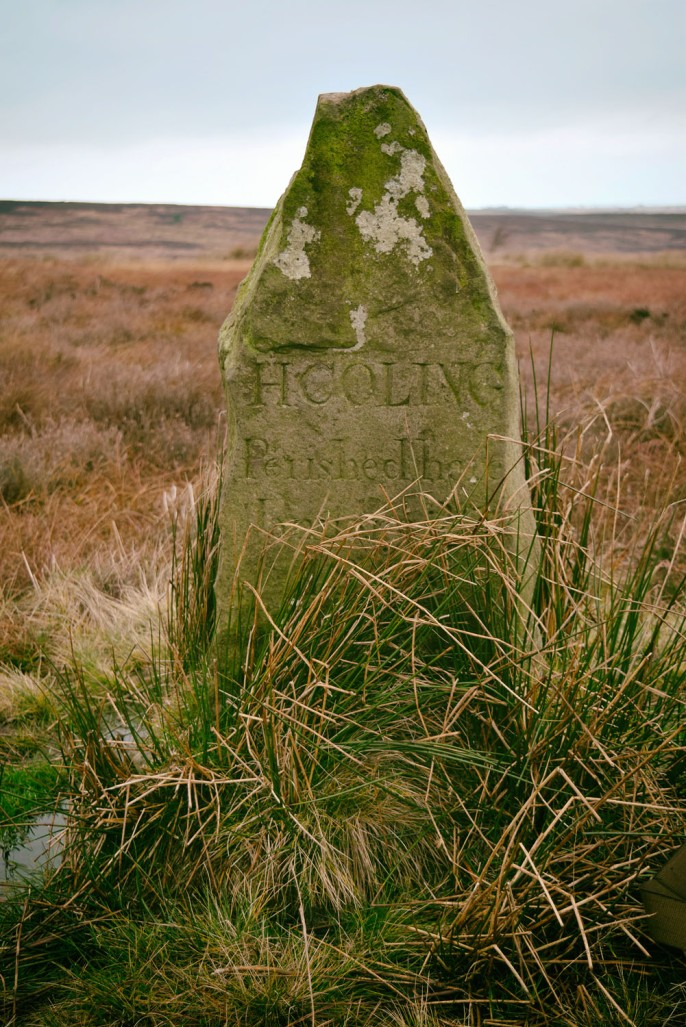 A lonely memorial stone in the middle of the moor. The inscription reads H COLING Perished here January 27 1848