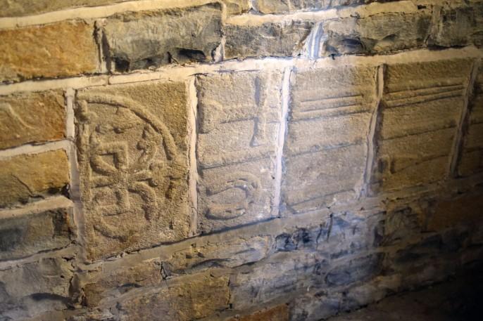 Stanwick Church blacksmiths cross slab with horseshoe & tools
